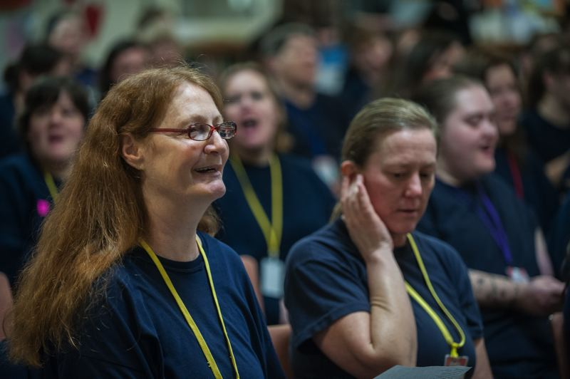 Photo Credit: SPOKESMAN PHOTO: JOSH KULLA - Coffee Creek Correctional Facility inmates Neva Honeycutt (L) and Lisa Sundquist sing along to Christmas tunes performed by an Oregon Symphony quintet Dec. 9.