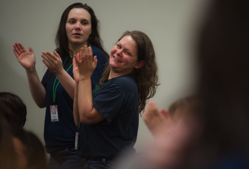 Photo Credit: SPOKESMAN PHOTO: JOSH KULLA - Coffee Creek Correctional Facility inmates Ashley Adams and Whitney Engstrom sing along to Christmas tunes performed by an Oregon Symphony quintet Dec. 9.