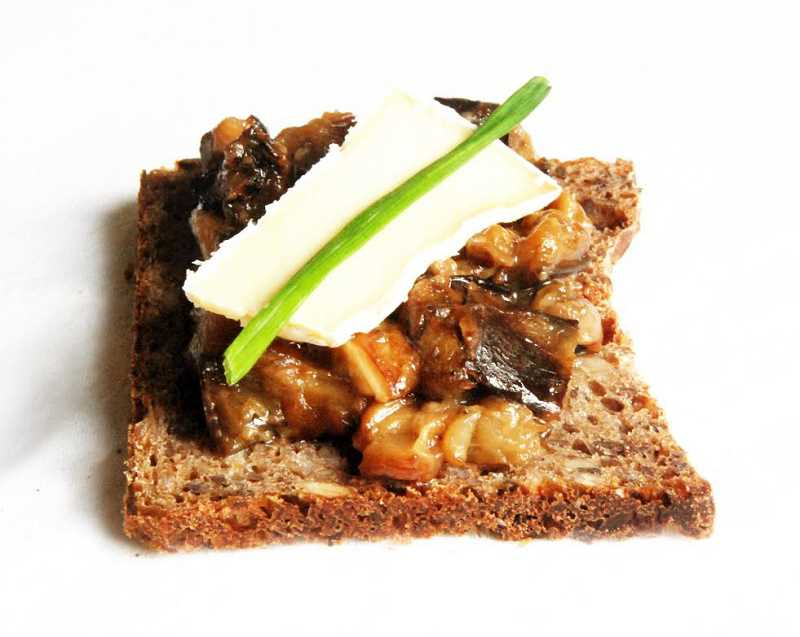 Burger enjoys putting nut butters on the breads. Two slices in the morning are a perfect breakfast. This slice is topped with roasted eggplant and brie.