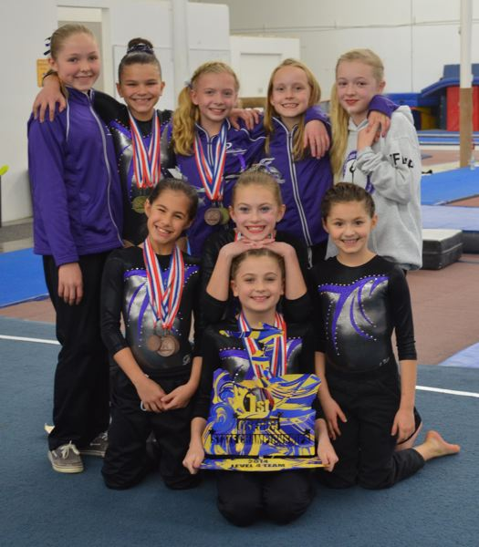 2d072e58f78e Photo Credit: SUBMITTED - Precision Elite Level 4 gymnasts pose proudly  with their championship hardware