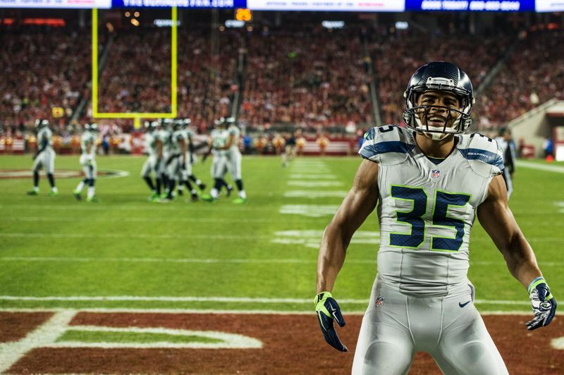 Photo Credit: COURTESY OF MICHAEL WORKMAN - DeShawn Shead, a defensive back and stalwart on special teams for the Seattle Seahawks, celebrates a big late-season victory over San Francisco.