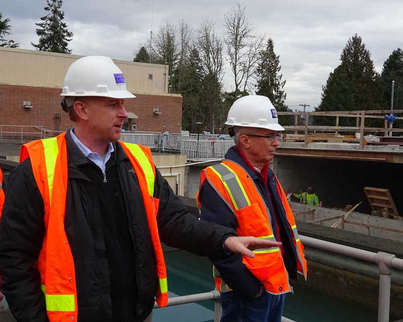 Photo Credit: SUBMITTED PHOTO - Mayor John Kovash listens as assistant construction manager Kyle Sandera describes progress on the new LOT water plant during a Jan. 22 tour.