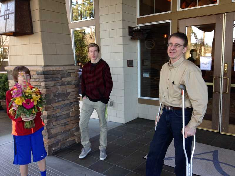 Photo Credit: SUBMITTED PHOTO - Chris Seigneur is joined by his sons - Augustin, 11, and Wesley, 17 - as he exits The Pearl rehabilitation center.