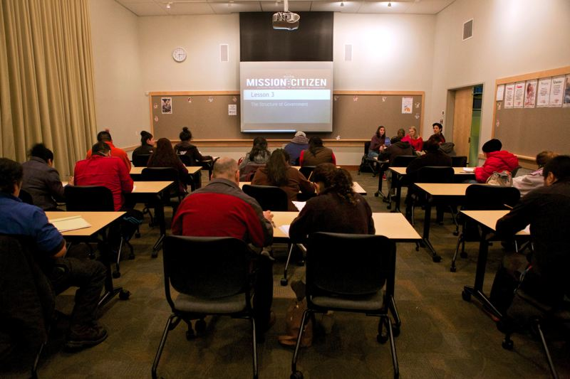Photo Credit: TIMES PHOTO: JAIME VALDEZ - Adults participate in a Mission Citizen class at the Tualatin Library.