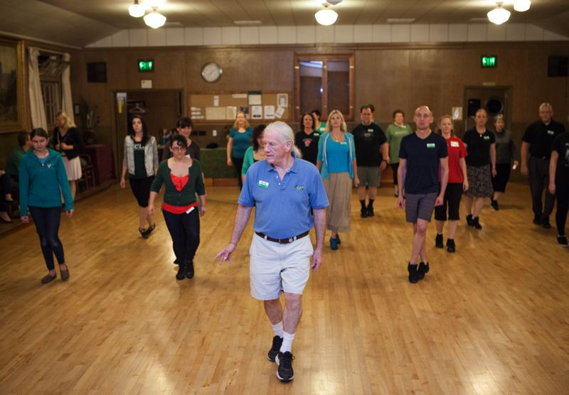 Photo Credit: TIMES PHOTO: ADAM WICKHAM - Every Thursday except Thanksgiving, people meet at Winona Grange in Tualatin for Irish dance classes, led by Sam Keator (center).
