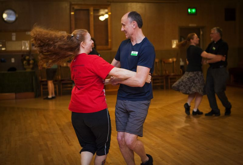 Photo Credit: TIMES PHOTO: ADAM WICKHAM - Students Wendy Griffin (left) and Marty Weldon dance in a class lead by Sam Keator.