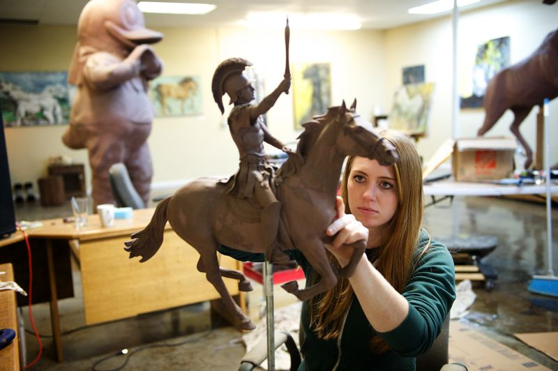 Photo Credit: OUTLOOK PHOTO: TROY WAYRYNEN - Sculptor Alison Brown works on a sculpture at the Troutdale Art Center. The renovated building hosts eight artists and opens Feb. 6.