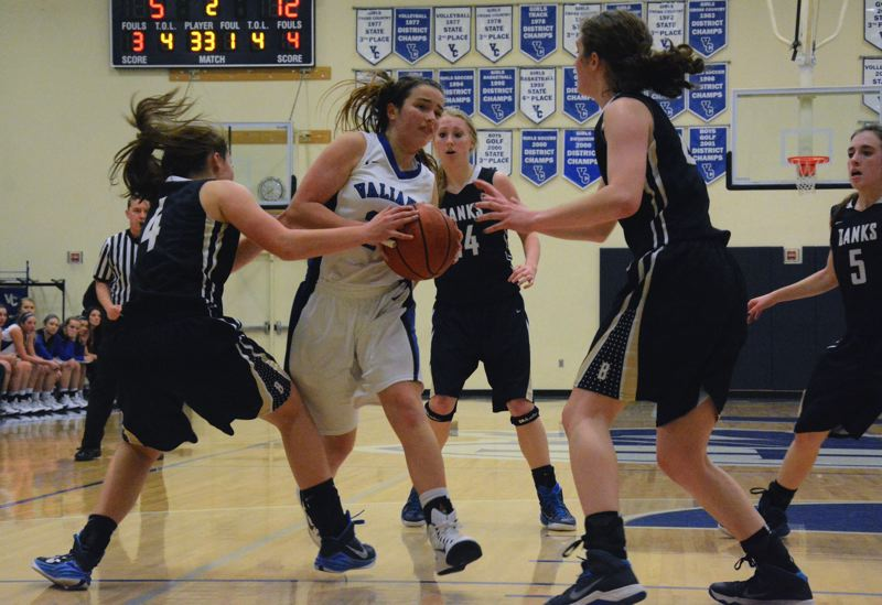 Photo Credit: TIMES PHOTO: MATT SINGLEDECKER - Valley Catholic freshman point guard Noelle Mannen drives to the basket against three Banks defenders in the first quarter of Valleys loss on Friday.