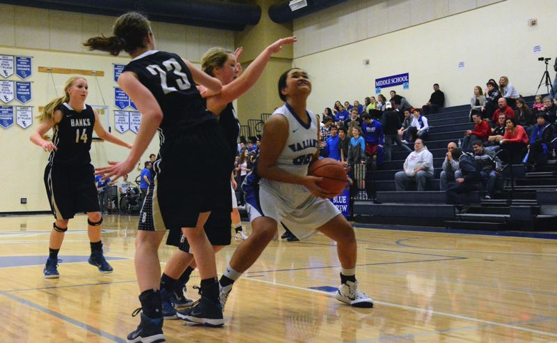 Photo Credit: TIMES PHOTO: MATT SINGLEDECKER - Valley Catholic senior wing Kaylynn Bush tries to create space underneath the hoop against Banks.
