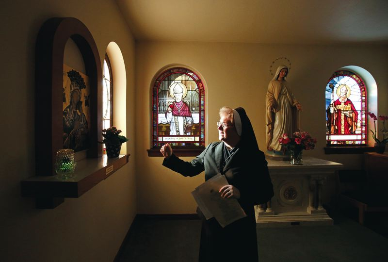 Photo Credit: TIMES PHOTO: JONATHAN HOUSE - Sister Michael Francine Duncan shows St. Marys cloister, which will be part of the open house.