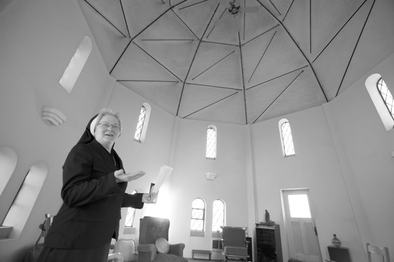 Photo Credit: TIMES PHOTO: JONATHAN HOUSE - Sister Michael Francine Duncan shows off the dome of St. Marys that will be part of the open house.