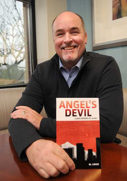 Photo Credit: STAFF PHOTO: VERN UYETAKE - Writing under the penname M. Louis, Lake Oswego accountant Mike Larson has published 'Angel's Devil.'
