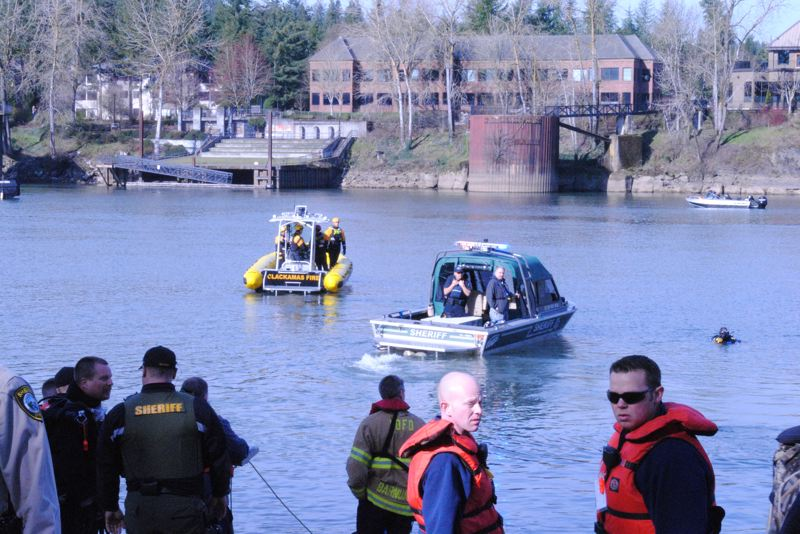 PHOTO COURTESY: CLACKAMAS FIRE - Clackamas Fire and Clackamas County Sheriff's Office dive crews search for the vehicle.