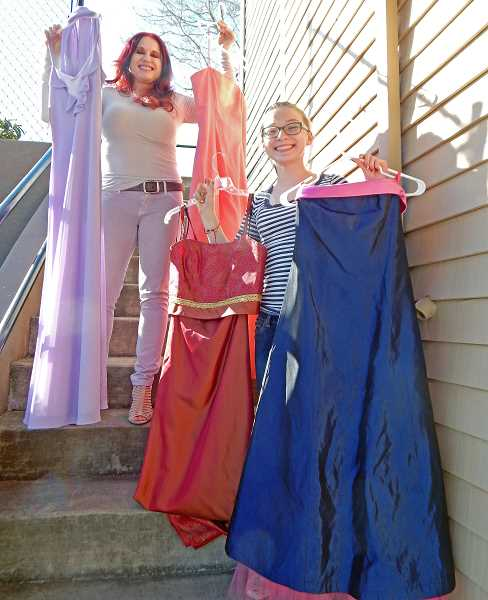 REVIEW PHOTO: JILLIAN DALEY - Lily Barna, 14, (right) shows off some of the dresses she and her mom Stacy Barna collected for Abbys Closet, a nonprofit organization.