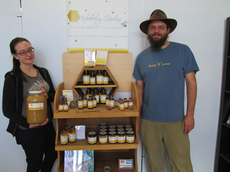 OUTLOOK PHOTO: SHANNON O. WELLS - Madelyn Morris, left, and her husband, Matthew Morris, have expanded Mickelberry Gardens, a bee-based wellness product business, into the former Bumblebee Farm organic grocery and Deli on Southeast 223rd Avenue.