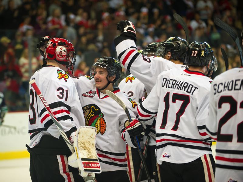 The Portland Winterhawks celebrate their 5-3 victory against the Seattle Thunderbirds Saturday at Memorial Coliseum.