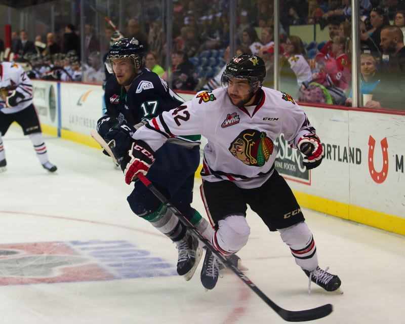 Layne Viveiros of the Winterhawks looks for the puck.