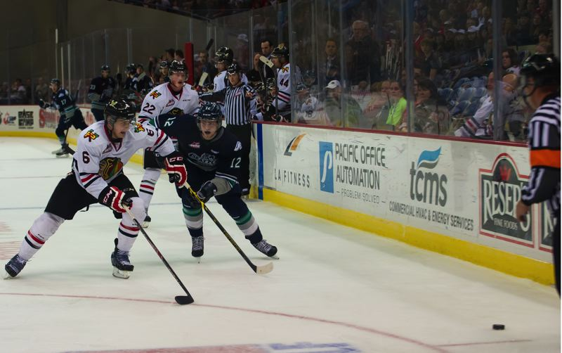 Portland's Adam Henry chases the puck ahead of Seattle's Ryan Gropp.