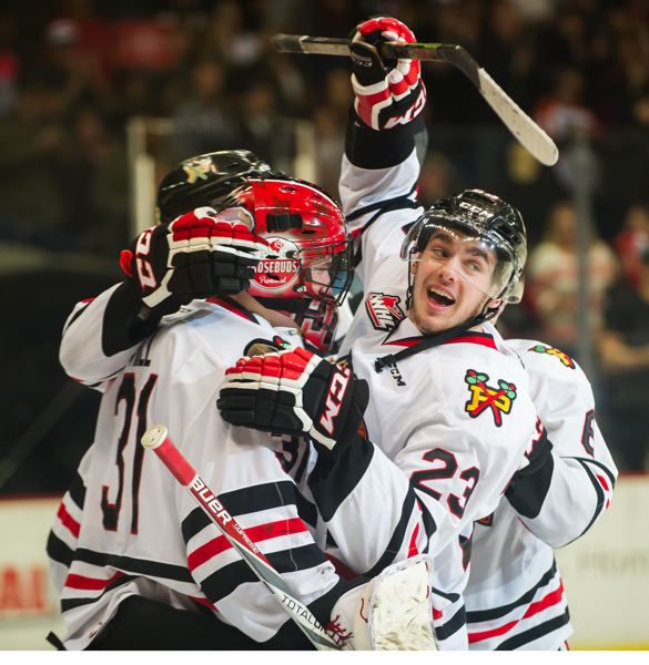 Dominic Turgeon (right), goalie Adin Hill and other Winterhawks celebrate as Portland wins 5-3 to take a 3-2 lead in its best-of-seven playoff series with Seattle.