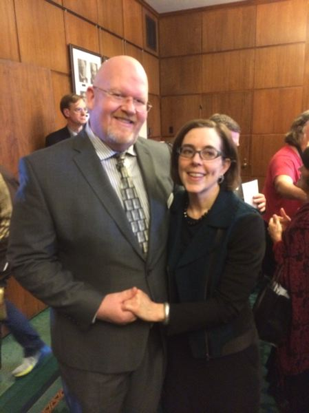 COURTESY PHOTO - Brett Bigham and Governor Kate Brown in Salem on March 23. Bigham was recognized on the floor of the House three days after his district put him on administrative leave.