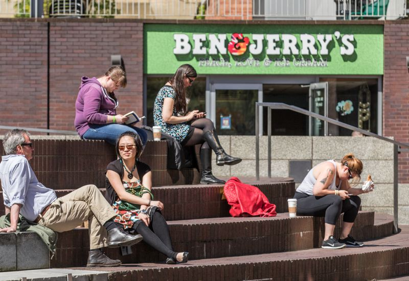 TRIBUNE PHOTO: JONATHAN HOUSE - Millennials take a lunch break near PSU.