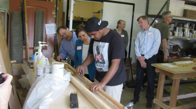 TIMES PHOTO: ERIC APALATEGUI - Students in the Wind & Oar Boat School at Merlo Station High School works on their projects while Congresswoman Suzanne Bonamici looks on during a visit this week.