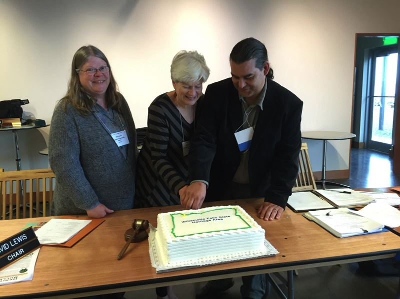 PHOTO COURTESY: JONATHAN STONE - Cutting the cake to celebrate the Willamette Falls Heritage Area Coalition's success are Jody Carson, vice president; Alice Norris, president of the WFHAC; and David Lewis, chairman of the Oregon Heritage Commission meeting at the Coos History Museum.