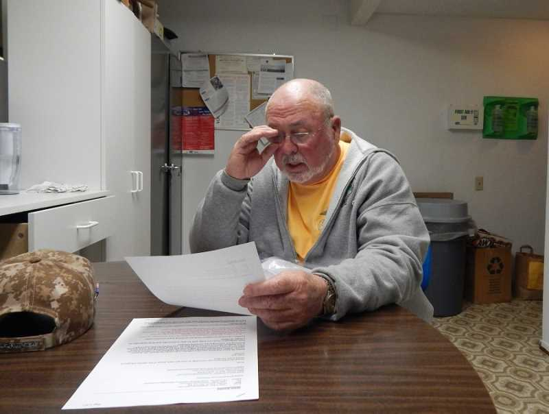 BARBARA SHERMAN - Jim Armour checks over the petition he is circulating around King City, hoping to gather enough signatures to force a recall election of the four remaining KCCA board members.
