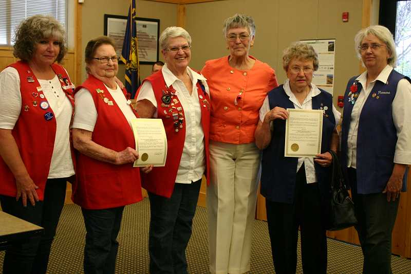 JASON CHANEY - Prineville Mayor Betty Roppe, third from right, read the Poppy Days proclamation on Tuesday during a city council meeting. Representatives from the American Legion Auxiliary and Veterans of Foreign Wars, shown here, were in attendance.