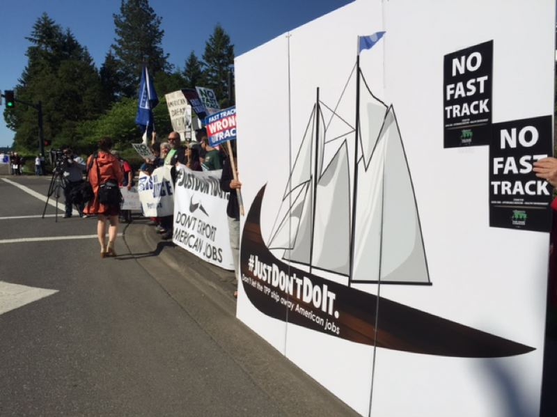 COURTESY OF ELIZABETH SWAGER/OREGON FAIR TRADE CAMPAIGN - Less than 100 protesters lined up outside Nike's Washington County headquarters campus during the President's visit.