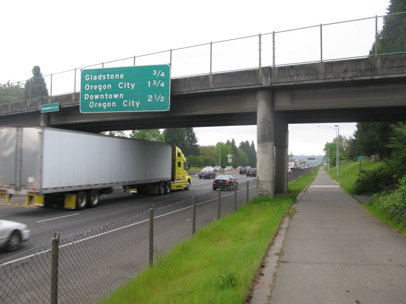 PHOTO BY: RAYMOND RENDLEMAN - Some people were upset that ODOT is planning to help larger semi trucks get under Strawberry Lanes Interstate 205 overpass without adding sidewalks or a bike lane to Strawberry Lane.
