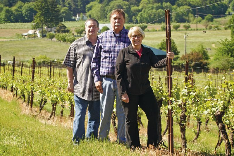 TIMES PHOTO: JAIME VALDEZ - Manager Kevin Craig (left to right) and owners Mike and Anne McCleskey stand in Horseleap Vineyard in Tigard.