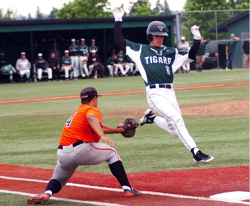 DAN BROOD - Tigard junior David Schimmels (right) jumps over a tag attempt by Roseburg sophomore first baseman Treven Jacks during Tuesday's state play-in game. The Tigers won 8-7.
