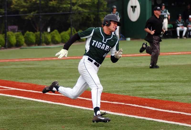 DAN BROOD - Tigard senior Brady McGetrick gets ready to round first base as he doubled in the fourth inning of Tuesday's state play-in game. McGetrick scored three runs in the Tigers' 8-7 win over Roseburg.