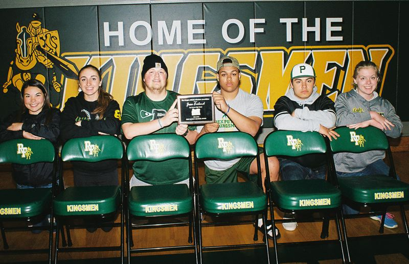 JOHN DENNY - Putnam students proudly display their Best Facility Remodel Award, posing with their new Kingsmen logo padded chairs in front of a new padded safety pad behind a basketball backboard. Pictured are: (left to right) Mikayla Schweinsberg, Sydney Nichols, Aaron Dolfay, Zach Potts, Jesse Countryman and Faith Whittington.