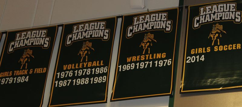 SUBMITTED - New banners indicate the years in which Putnam sports teams have won league titles.