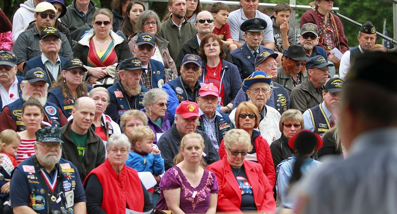 TIMES PHOTO: MILES VANCE - Members of audience listen to American Legion Post #124 Commander Steve Gerber during the Memorial Day event at Beaverton Veterans Memorial Park on Monday, May 25.
