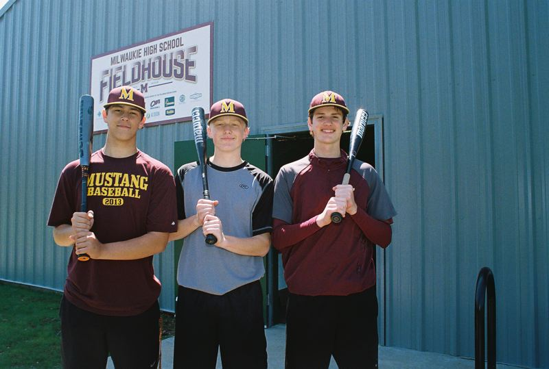 JOHN DENNY - High school baseball players (left to right) Riley Howard, Noah Miller and Brad McVay were at Milwaukies field house to practice on May 2, when the new facility was dedicated.