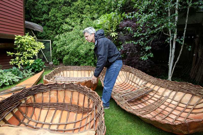 TIMES PHOTO: JONATHAN HOUSE - Steve Carrigg, of Tigard, has a passion for boating. He has been carving - and weaving - his own canoes, kayaks and Irish coracles out of local materials for years.