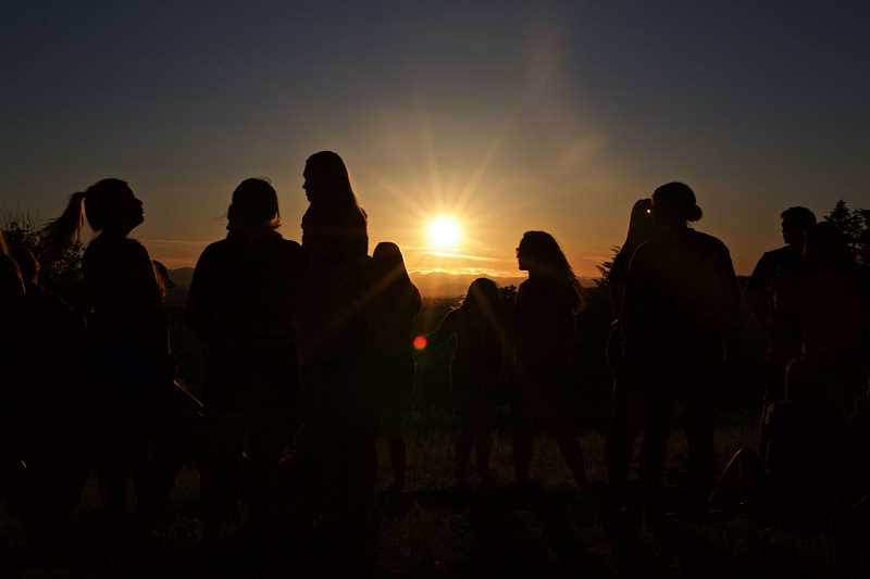 TIMES PHOTO: JAIME VALDEZ - Students at Tigard High School gather at Sunrise Park on Bull Mountain to watch the sunset on the eve of their graduation. It's a tradition that takes back years, and helps students celebrate the end of their high school lives, and the beginning of the next chapter.