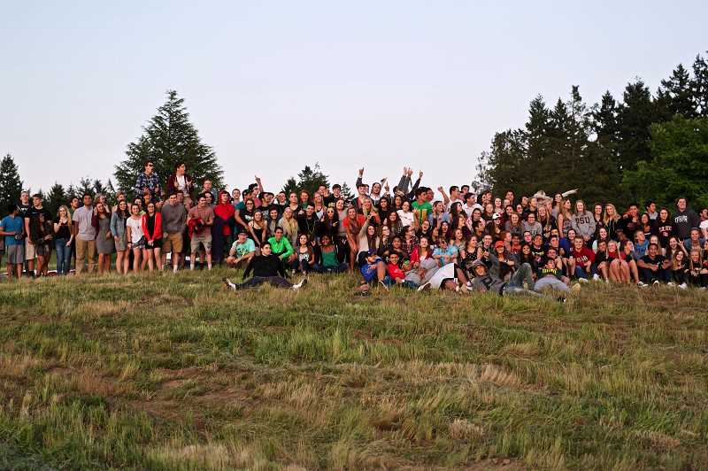 TIMES PHOTO: JAIME VALDEZ - The Tigard High School class of 2015 poses for a group photo as the sun sets on June 4, the night before they graduate.