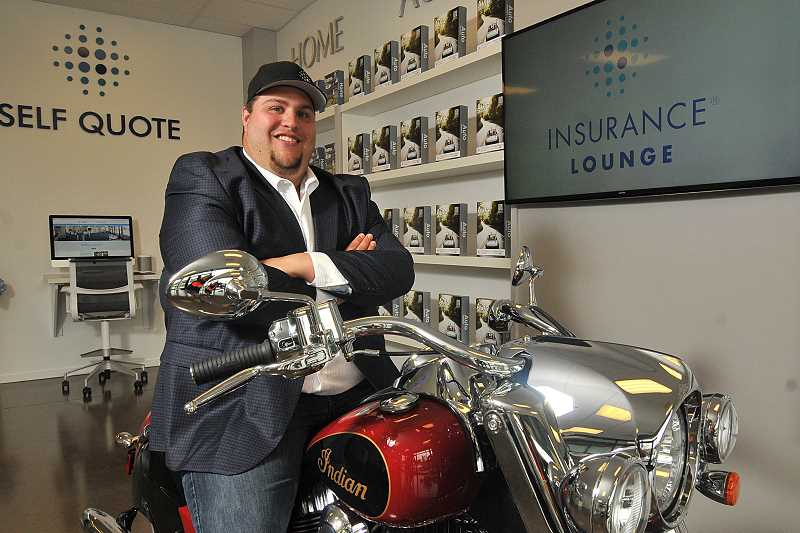 STAFF PHOTOS: VERN UYETAKE - Michael DeLaGrange sits aboard a motorcycle in the Insurance Lounge. The business aims to bring the convenience and ease of retail shopping to the insurance industry.