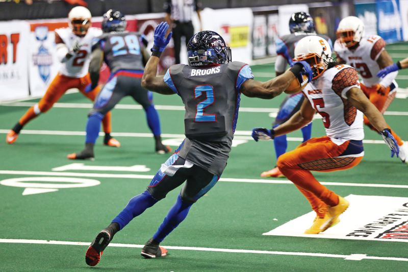 TRIBUNE PHOTO: DAVID BLAIR - Duane Brooks of the Portland Thunder makes a move against an onrushing defender. Brooks leads the Arena Football League in kickoff returns for touchdowns this season with five.