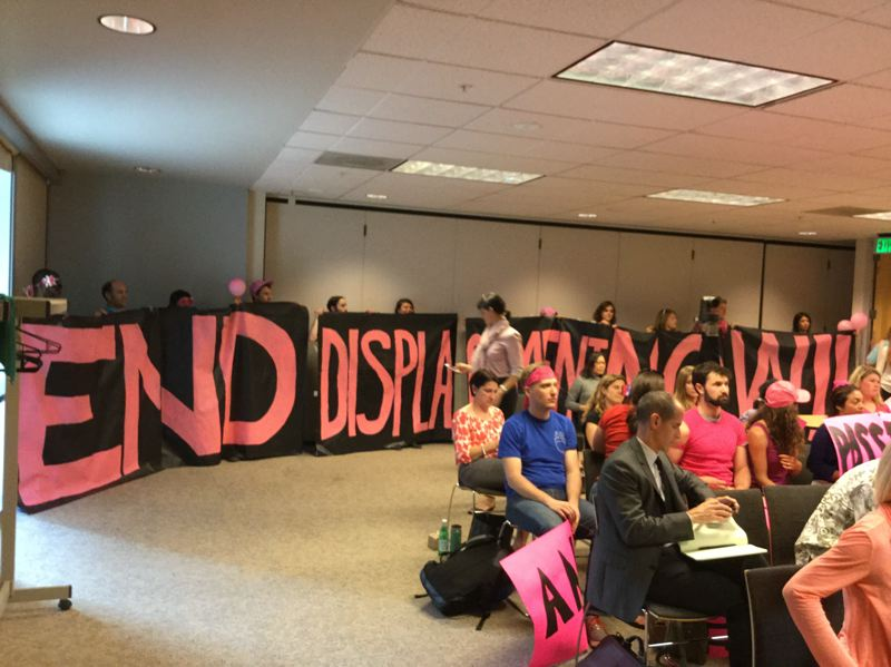 PHOTO BY STEVE LAW - Anti-gentrification activists hold signs at Tuesday night's Planning and Sustainability Commission calling to 'End Displacement Now.'