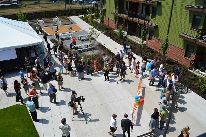 HILLSBORO TRIBUNE PHOTO: KATHY FULLER - Orchards at Orenco, touted as the largest passive house building in the United States, opened Monday with plenty of pomp and circumstance.