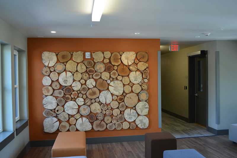HILLSBORO TRIBUNE PHOTO: KATHY FULLER - Architect Ankrom Moisan designed this mural of wood rounds to pay tribute to the historic orchards in the Orenco area. Wood round murals are mounted on all three floors of the building and represent 15 different species of trees.