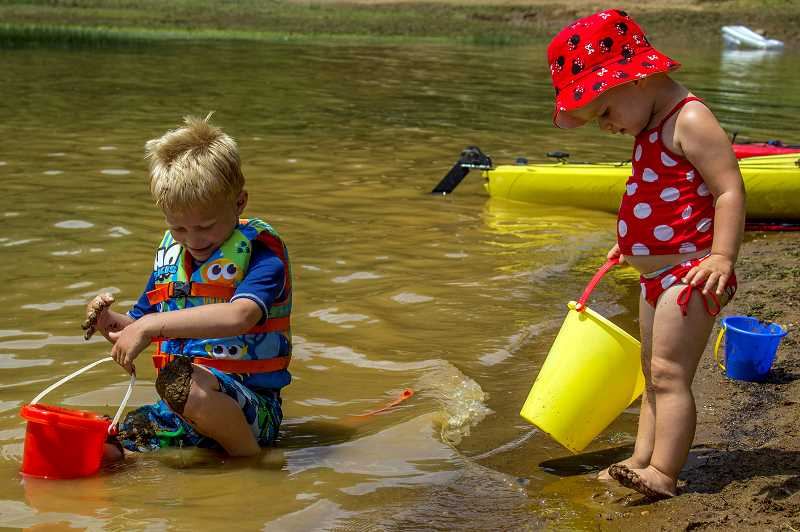 HILLSBORO TRIBUNE PHOTO: TRAVIS LOOSE - Cameron, 5 (left), and Mallory Kurth, 2, enjoy the warm waters at Hagg Lake on Saturday, June 27. They and their parents, Joe and Robin Kurth, traveled from Tigard to cool down a little bit and have some fun, they said.