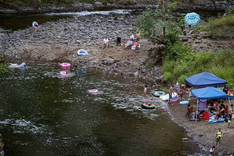 HILLSBORO TRIBUNE PHOTO: CHASE ALLGOOD - Swimmers enjoy the cool water of the Wilson River Sunday.