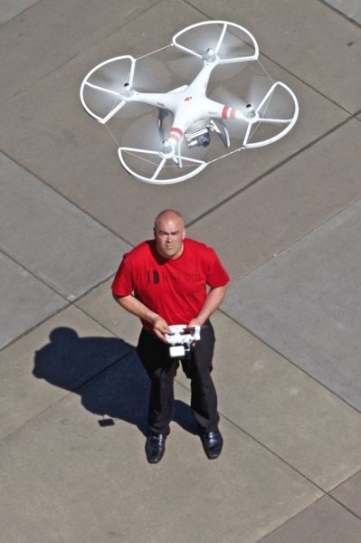 TIMES PHOTO: JAIME VALDEZ - Real estate broker Jesse Dill demonstrates the use of his drone for aerial photography. He was preparing to photograph the Last Tuesday event for the Beaverton Area Chamber of Commerce but also employs drones to capture striking photos and videos he uses to market properties.