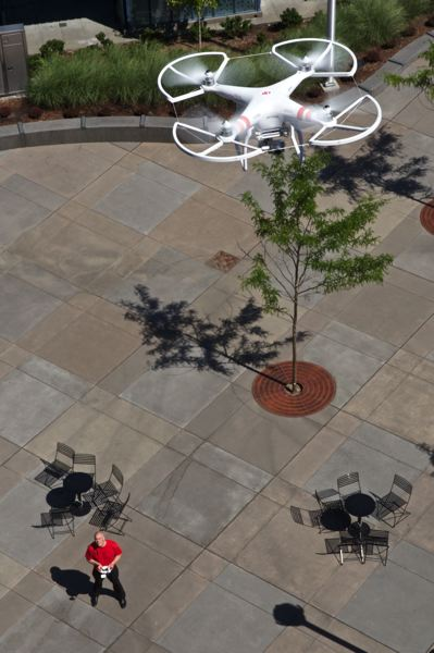 TIMES PHOTO: JAIME VALDEZ - Jesse Dill demonstrates how he uses a drone to capture photographs of the property he sells.